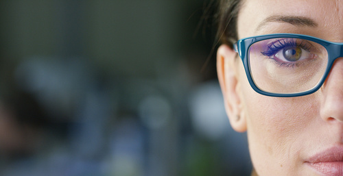 Portrait of a beautiful girl with glasses, with green eyes, shot